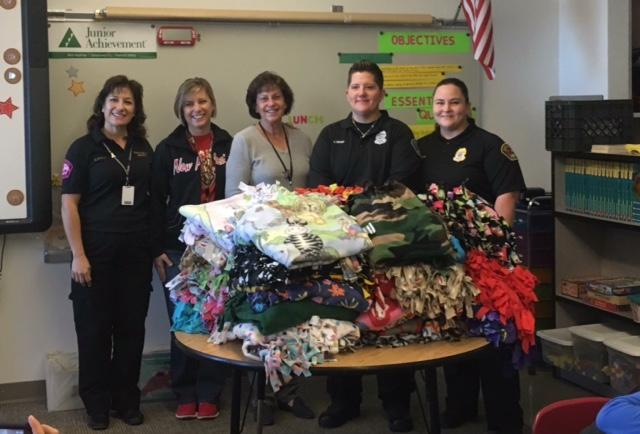 Ms. Lowther and Ms. Henry donating blankets to APD
